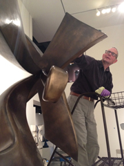 Tom Fuller conserving Manuel Izquierdo's sculpture Constellation at the Hallie Ford Museum of Art.