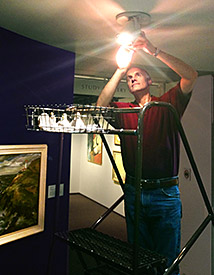 David Anderson installs the new LED lights at the Hallie Ford Museum of Art.