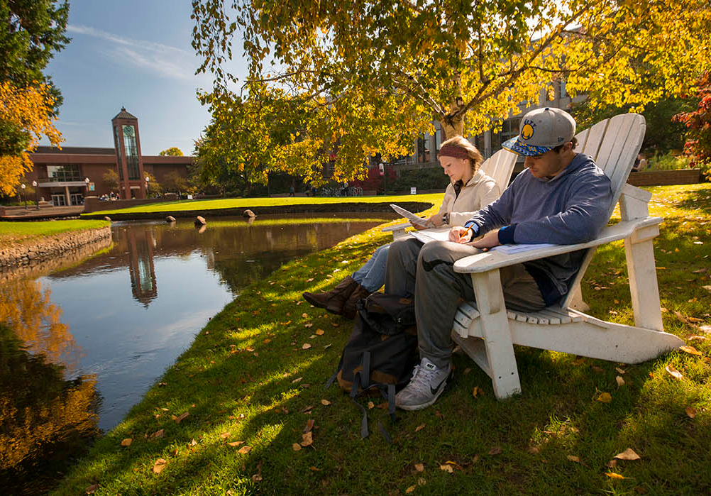 Students studying by the Mill Stream