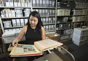 female student looks through archives