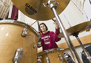 Male student playing drums
