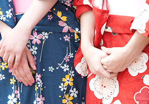 Hands clasped together on a japanese dress