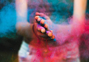 Hands dusted in colored powder