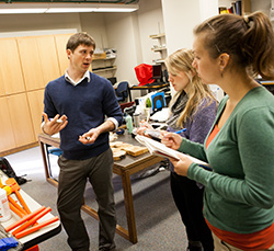 Evan Larson '02 interacts with students in an environmental science class at Willamette.