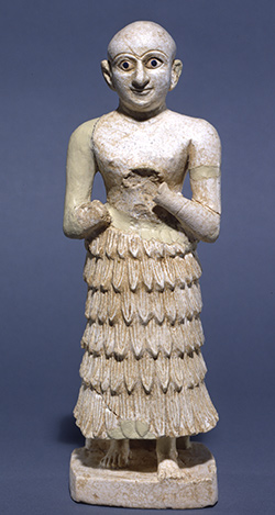 """Male figure,"" Iraq, excavated from the Nintu Temple, Mid-to-Late Early Dynastic Period, 2700–2500 BCE; University of Pennsylvania Museum of Archaeology and Anthropology, Joint Bagdad School/University Museum Expedition to Mesopotamia, 1937, 37-15-28."