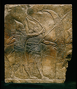 """Relief fragment with a battle scene,"" Iraq, excavated by William Kennett Loftus in August of 1854; Seattle Art Museum, Eugene Fuller Memorial Collection and Hagop Kevorkian, 46.49."