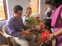 Henry Harrison '13 and Shannon Waltz '14 received gifts of flower bouquets while traveling throughout Jkarkhand, India, this past summer.