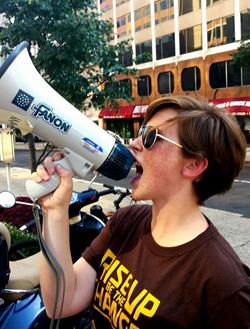 Willamette student, Natalie Pate '15, speaking into a megaphone