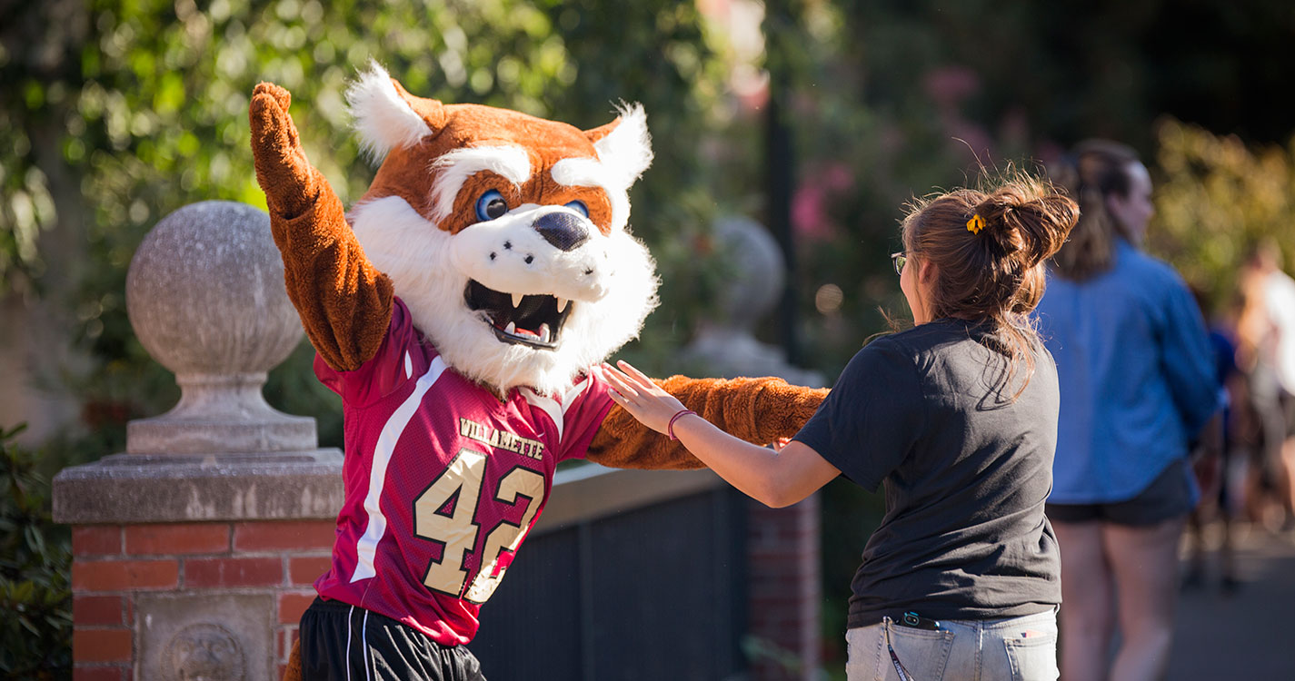 Blitz hugging a student at Opening Days