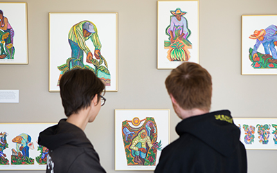 students viewing Betty LaDuke art exhibition