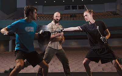Associate Professor Jonathan Cole teaches the art of stage combat to Will Bremer '18 (left) and William Forkin '19.