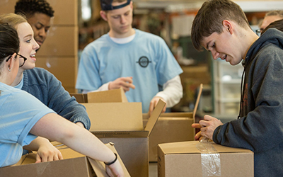 Students pack boxes as part of Willamette's Global Day of Service