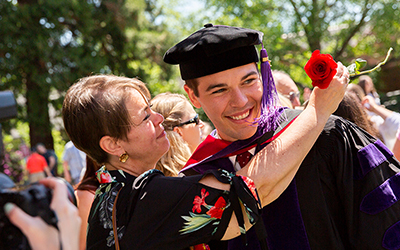Law graduate gets embraced by woman with a rose