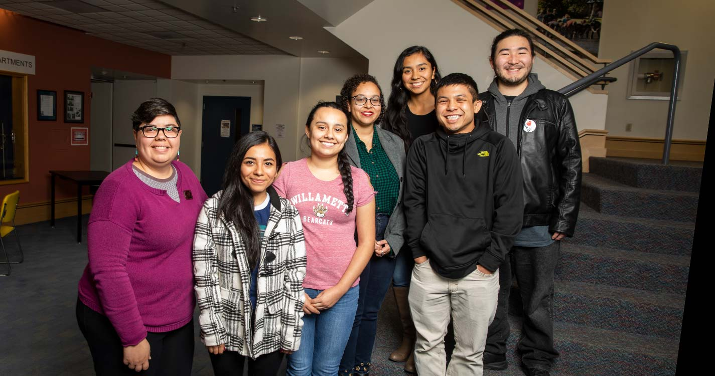 Assistant Professor Rosa Leon-Zayas and students stand on a stairwell