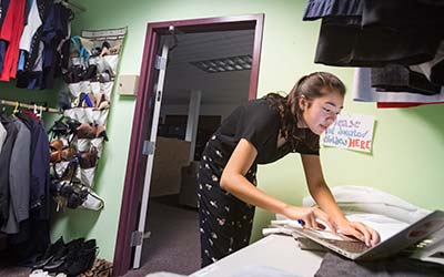 Michelle Hicks '20, co-coordinator of the Clothing Share, checks the inventory.