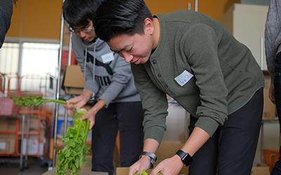 Students pack food for Global Day of Service