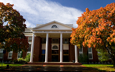 Willamette College of Law building with autumn colored trees