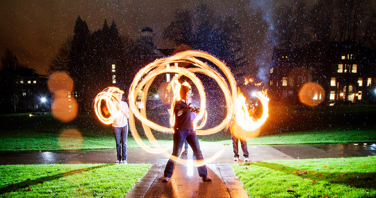 Fire spinning club performance on the Quad