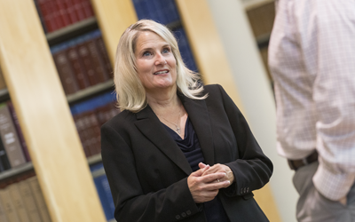 Tamara Palmer stands in the law library