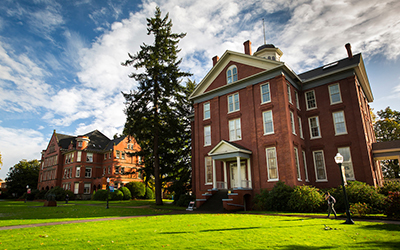 Waller Hall and Eaton Hall before a green lawn