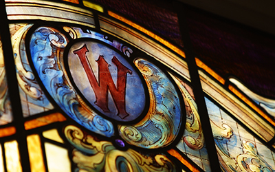 stained glass window with cardinal W