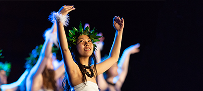dancer with hands extended during 2019 luau